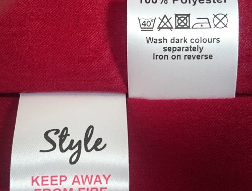 A sample of fabric clothing care labels