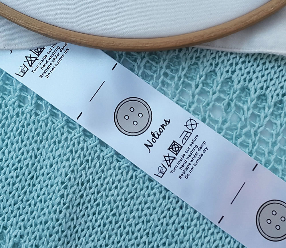 Sewing labels uk - button